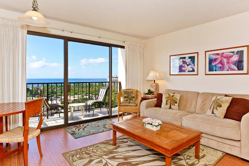 Four Paddle #1606 - Secure one-bedroom with full kitchen, parking & ocean/sunset views! - Image 1 - Waikiki - rentals