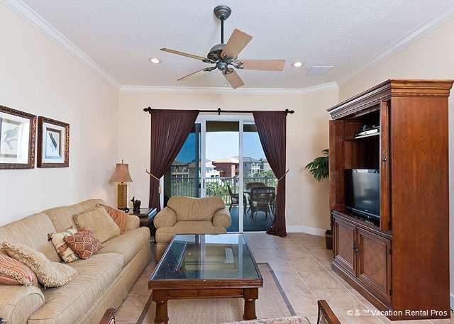 Living room is bright and sunny and features tile floors. - 242 Cinnamon Beach, 4th Floor, Ocean Hammock Golf View, 2 pools - Palm Coast - rentals