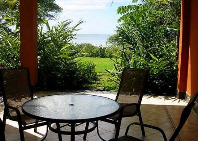 Patio - Luxury beachfront condo- shared pool, custom kitchen, patio, central a/c - Tamarindo - rentals