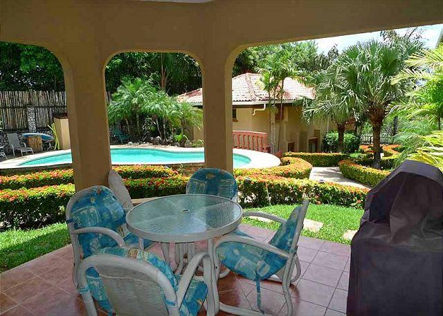 Patio - Nice groundfloor condo- near beach, shared pool, cable, gas grill, a/c - Tamarindo - rentals