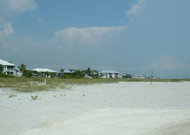 Beach with Buildings in distance - Beach & Gulf Villa at Palm Island Resort with All Resort Amenities - Cape Haze - rentals