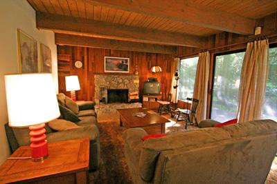 Open living area with stone fireplace - #27 - Cedar Cabin in Glacier Springs - Glacier - rentals