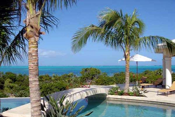 Snorkel right outside your front door on Smith's Reef, or just walk for miles on the sugar- white sandy beach. TNC AVA - Image 1 - Grace Bay - rentals