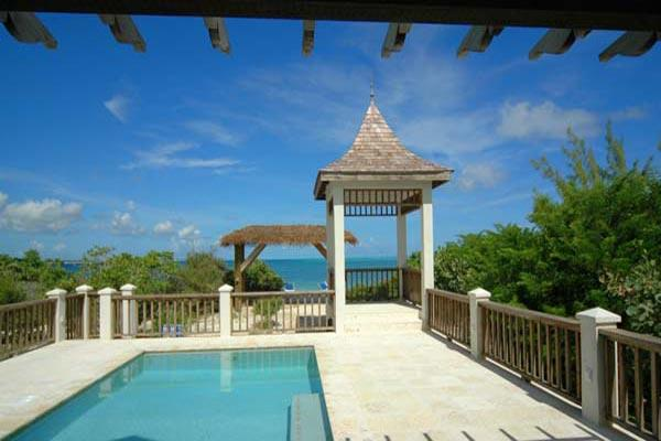 Excellent swimming 5 minutes away, this villa boasts unobstructed sunset views. TNC CAL - Image 1 - Grace Bay - rentals