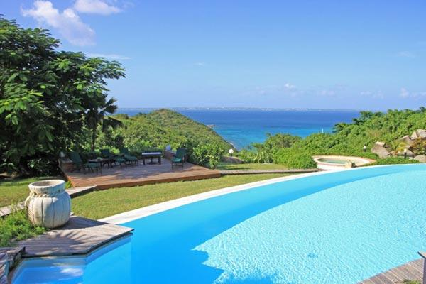 This secluded villa with views of the Caribbean and Anguilla is perfect for a large retreat. C COL - Image 1 - Hillside - rentals