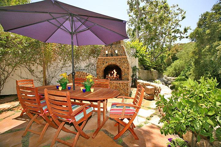 Creekside patio and outdoor fireplace - Seaside Cottage - World - rentals
