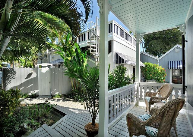 Landscaped Community Courtyard and Unit's Furnished Front Porch Area - Family House - Nightly - Key West - rentals