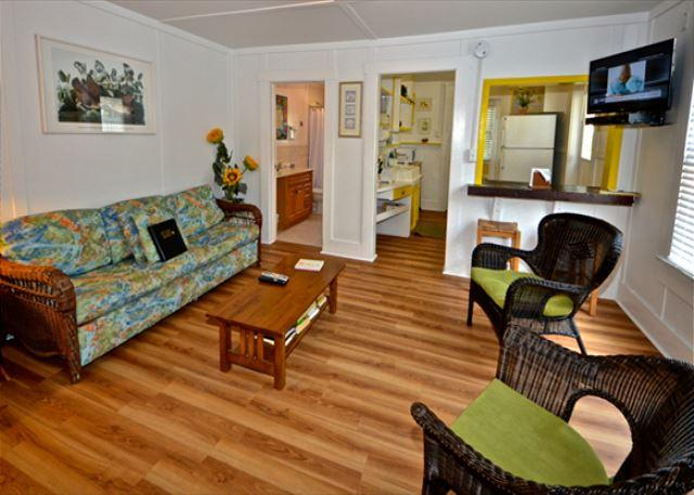A Spacious Living Room Area With a Flat Screen TV and Comfortable Tropical Furnishings. - Orchid Suite - Nightly - Key West - rentals