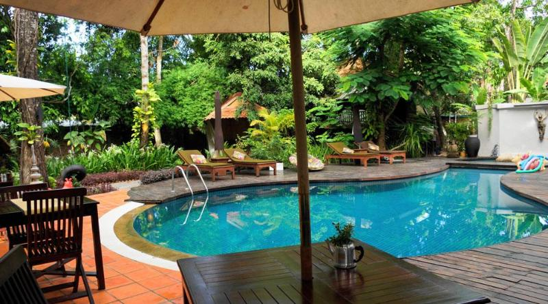 Jungle pool are with sun lounges and gardens - The RiverGarden Hotel, Siem Reap - Siem Reap - rentals