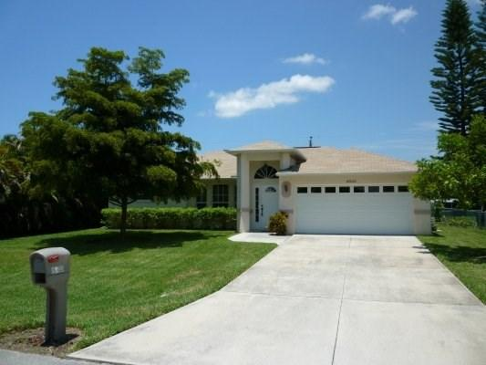 Cape Escape Front Elevation - Cape Escape - 3/2 Electric Heated Pool Home, Fenced Yard, High Speed Internet - Cape Coral - rentals