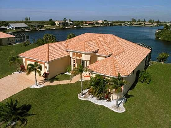 Front Elevation Aerial with Palm Trees - Villa Bella Vista 3/2 Elec. Heated Pool, Gulf Access, Lake View, Boat Dock, Wifi HS Internet - Cape Coral - rentals