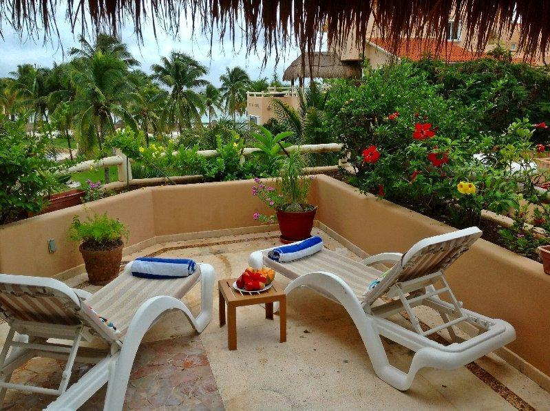 Private terrace overlooks the beach and pool - Casa Amanecer sweeping beach and ocean views - Puerto Aventuras - rentals