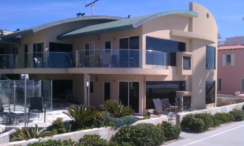 The property is on the ground floor with the Private Oceanfront patio - 14ft wide Oceanfront Window to waves Luxury Condo - Mission Beach - rentals