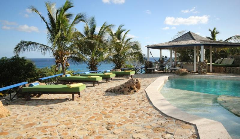 Pool side plenty of places to catch the rays - The Carib House Turtle Bay Falmouth Antigua - Falmouth - rentals