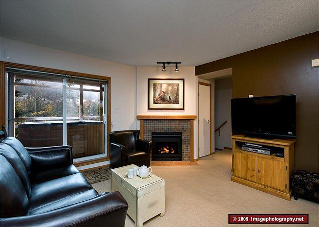 Living room with 40 inch TV - 28 Glaciers Reach, this 2br home has a hot tub & pool in Whistler Village - Whistler - rentals