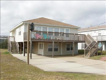 Exterior of home showing large deck and basketball backboard - Carkee 7332 - Kitty Hawk - rentals