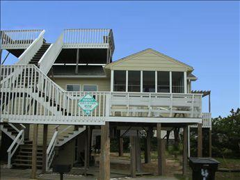 Exterior of duplex shows open roof level deck, screened porch as well as 2 open decks - High Tide 7346 - Kitty Hawk - rentals