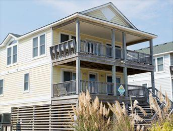 Exterior of home taken from the beach road shows lots of open decking - Sea Winds #5 10585 - Kill Devil Hills - rentals