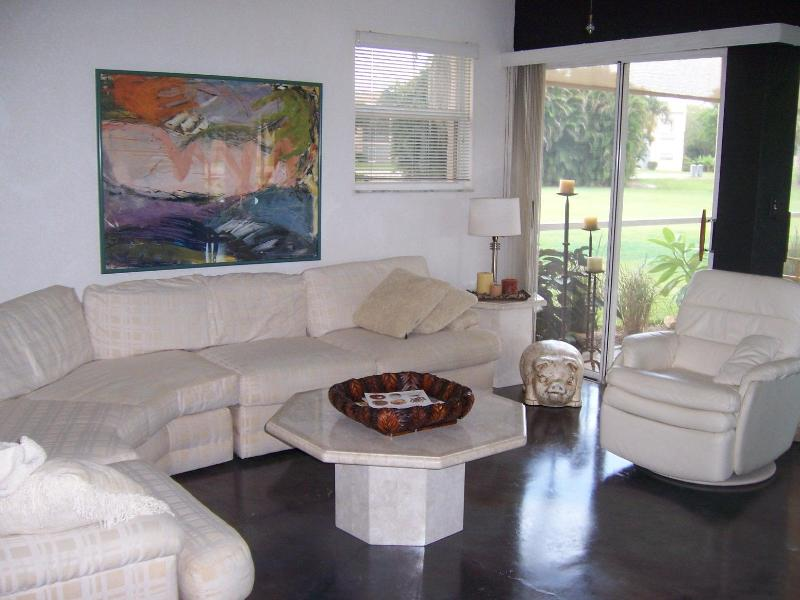 Living Room with Golf course view and lanai - Lovely Condo Lovely View - Quail Run Golf Course - Naples - rentals