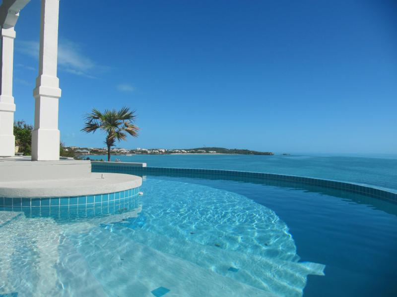 View from your private freeform pool to Sapodilla Bay - Oceanfront, pool and dock on Ocean Pt  *Specials!* - Ocean Point - rentals