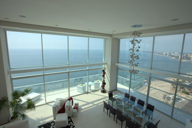 The two-story atrium with sweeping, oceanfront views is the centerpiece of the penthouse - 2-story, luxury beachfront penthouse in Vallarta - Puerto Vallarta - rentals