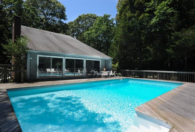 Enjoy a swimming pool that is just steps away from the living room and dining area. - The Driftwood - complete privacy in East Hampton - East Hampton - rentals