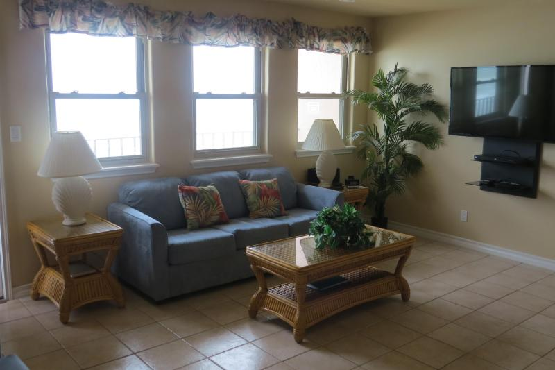 One of two couches in Living Room with a 50 inch TV - Large 3 Bedroom Beachfront Condo-check for special - South Padre Island - rentals