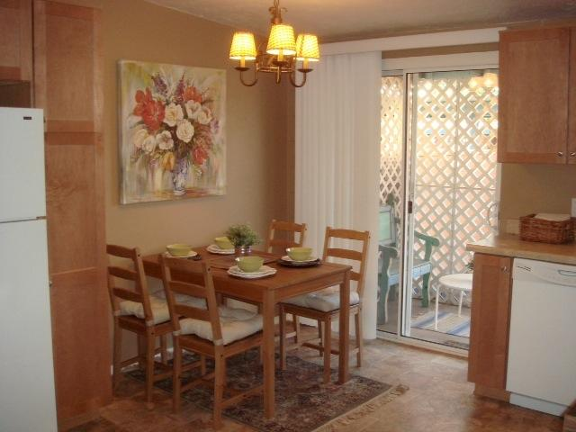 Dining table and door to backyard - AZ Inn Historic Neighborhood-Bella Casa O - Tucson - rentals