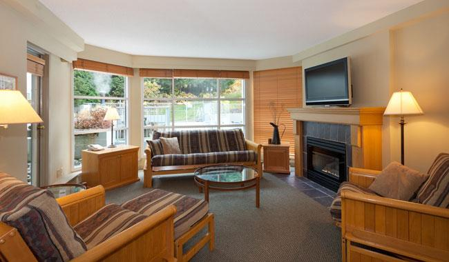 Bright Living Room with Gas Fireplace and Mountain Views - Woodrun 204 | Whistler Platinum | Ski-in/Ski-Out - Whistler - rentals