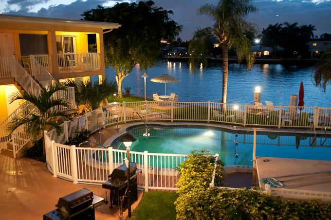Intracoastal and Heated Swimming Pool at night - Beautiful Efficiency Studio on the Intracoastal - Pompano Beach - rentals