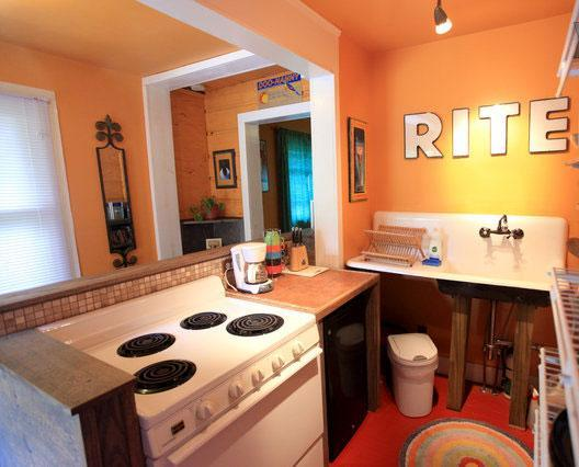 Kitchen with full sized stove, mini fridge with freezer, and coffee pot. - Cheery Asheville Artist Studio-2 miles to Downtown - Asheville - rentals