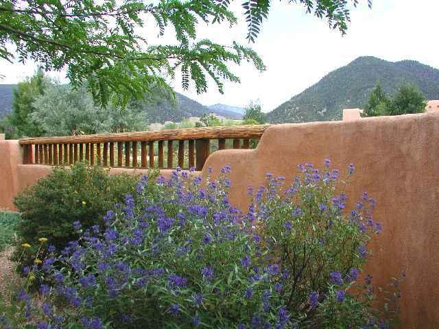 View to Taos Mountain from adobe privacy wall wall front patio - Casa Luminosa - Taos - rentals