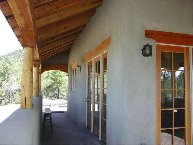 Looking at entry from parking area - mountains everywhere - Coyote Mountain Luxury Cabin - Taos - rentals