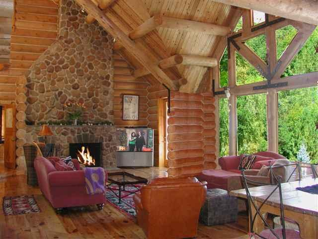 Expansive window walls offering expansive mountain, valley, sunset views - El Salto Log Home - Taos - rentals