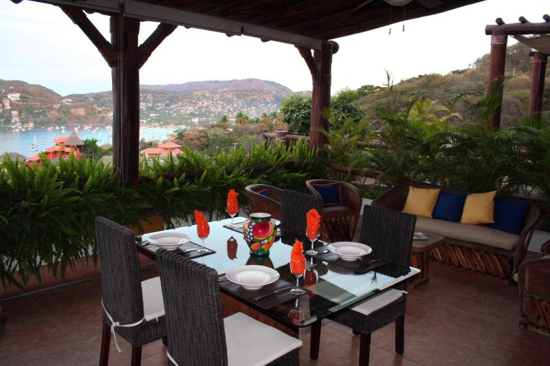 Enjoy dinner on terrace with beautiful Bay views. - OceanView 2 BR Condo-Breathtaking Bay-Ocean Views - Zihuatanejo - rentals