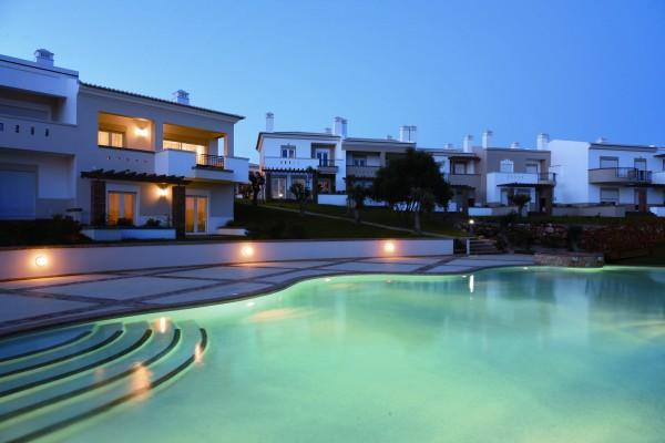 View across the pool at night - Casa Mimosa - Luxurious 2 bedroom village house - Algarve - rentals