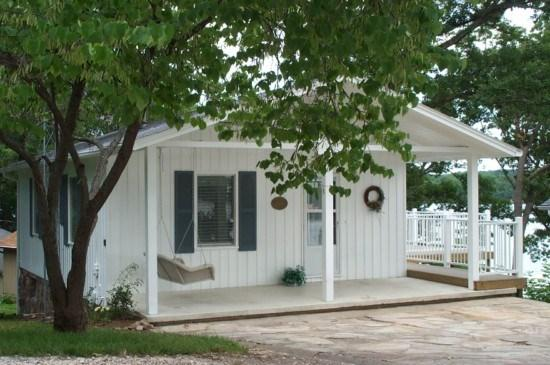 Roadside of House with Covered Porch, Swing and Deck Access - Casablanca - 2 Story Family Home With Main Channel View of the Lake. 7MM Osage Arm - Main Channel. - Lake of the Ozarks - rentals
