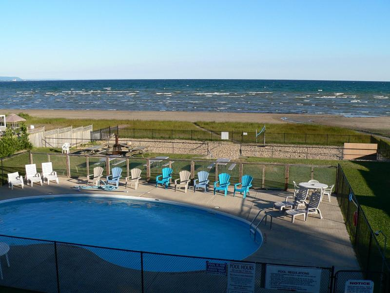 Pool area and beach from your private balconies - AA1 - Beach Front available this summer!!  Book early to avoid disappointment - Wasaga Beach - rentals