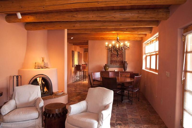 Living Room With Wood Burning Kiva Fireplace - Girard Gardens Casa - Santa Fe - rentals