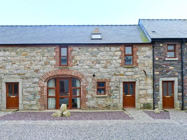THE COACH HOUSE, COASTGUARD COURT, family friendly, with a garden in Cullenstown, County Wexford, Ref 3928 - Image 1 - Ireland - rentals