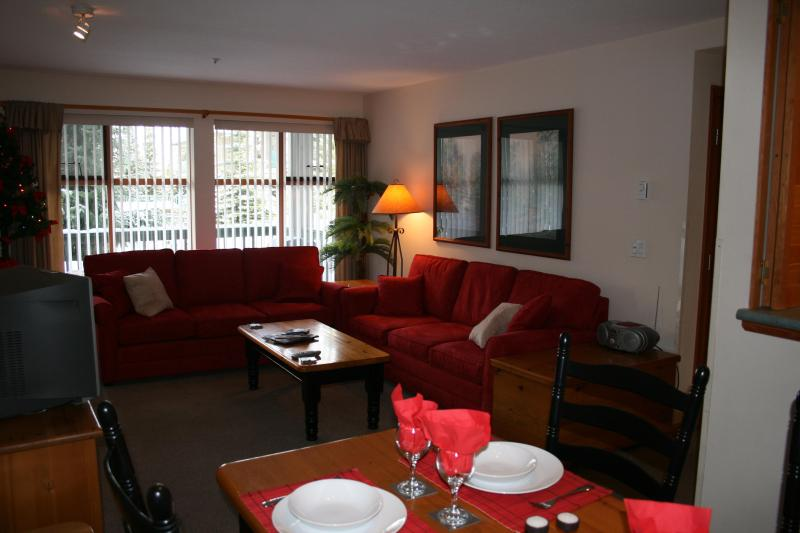 Enjoy our comfortable living room with its stunning red couches. - Very popular, fully equipped luxury 1 BR Condo!! - Whistler - rentals