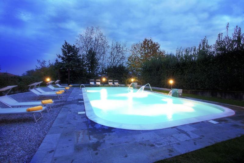 The pool as viewed at night - Griante  residence. Apartment 2 - Griante - rentals