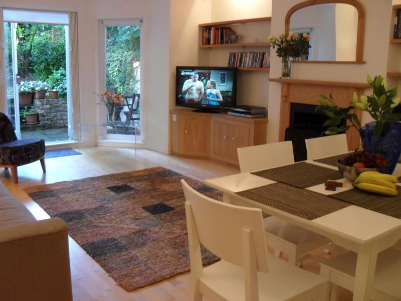 Very spacious living room leading to patio garden - Primrose Hill Fab 3 bed Garden Apartment - London - rentals