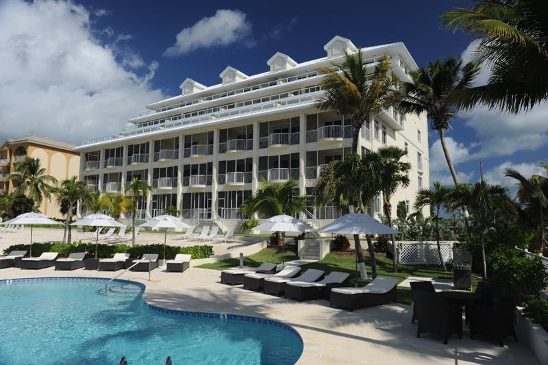 View from poolside to building - NEWEST LUXURY VACATION VILLAS on Seven Mile Beach! - Seven Mile Beach - rentals