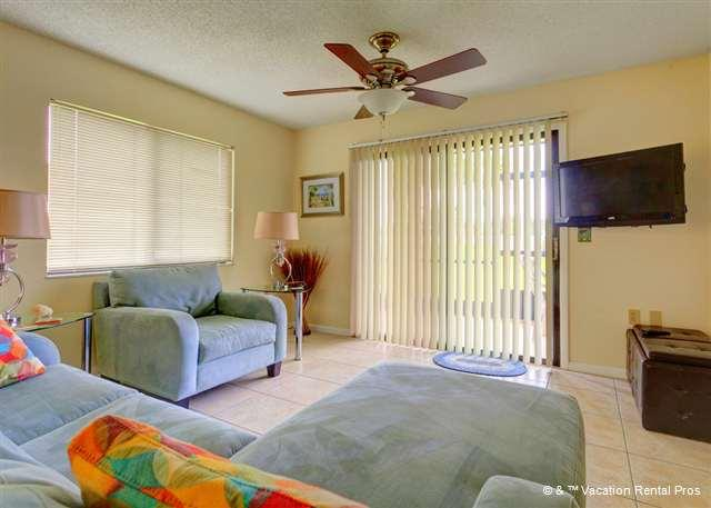 Settle into our ultra-comfy couch and watch HDTV - Ocean Village N12, Ground Floor Unit, Screen Lanai, 2 pools - Saint Augustine - rentals