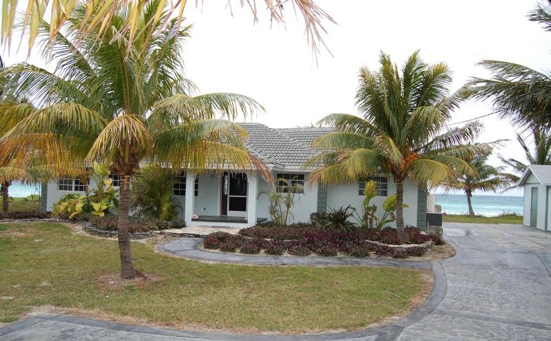 Front view of our home w/ ocean behind! - Oceanfront Home with Truck & 14' Boat included !! - Grand Bahama - rentals