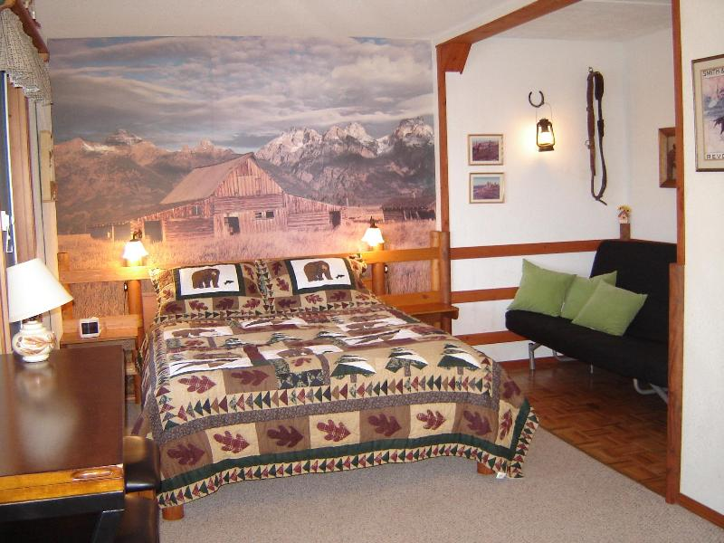 queen size bed and futon on right/sleeps child - Selfcatering vacation suite in beautiful setting - Vernon - rentals