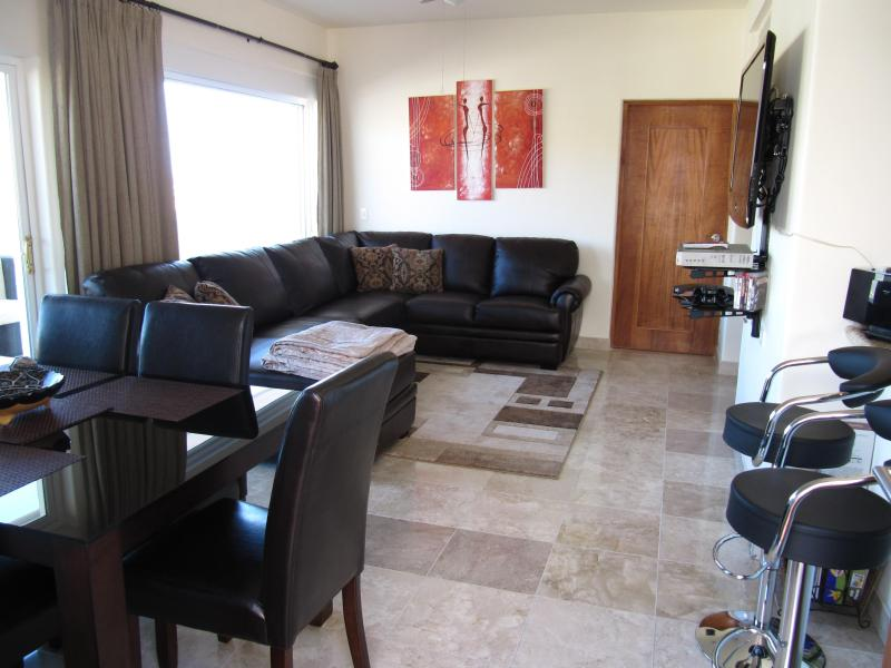 Enjoy the Comforts of First Class Living in Your Open Plan Living and Dining Area. - 3 Bedroom Portofino Condo - Pedregal - Great Value - Cabo San Lucas - rentals