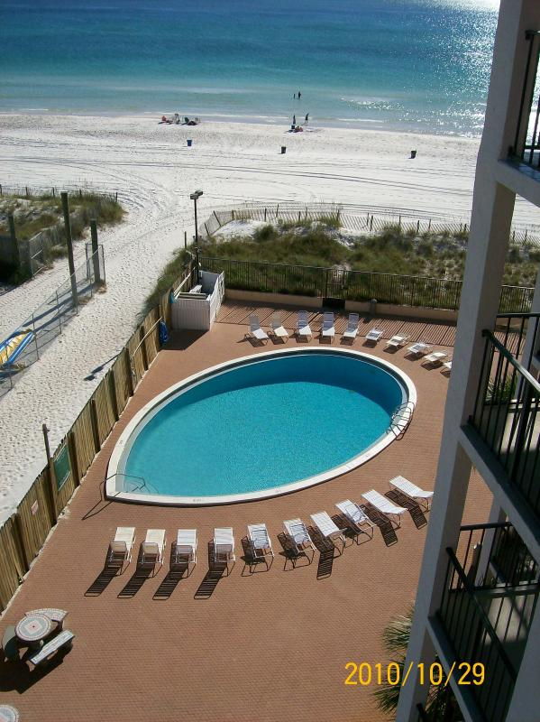 Your pool and beach view from the balcony. - Summer Specials- Moondrifter 706 1BR GULF FRONT - Panama City Beach - rentals