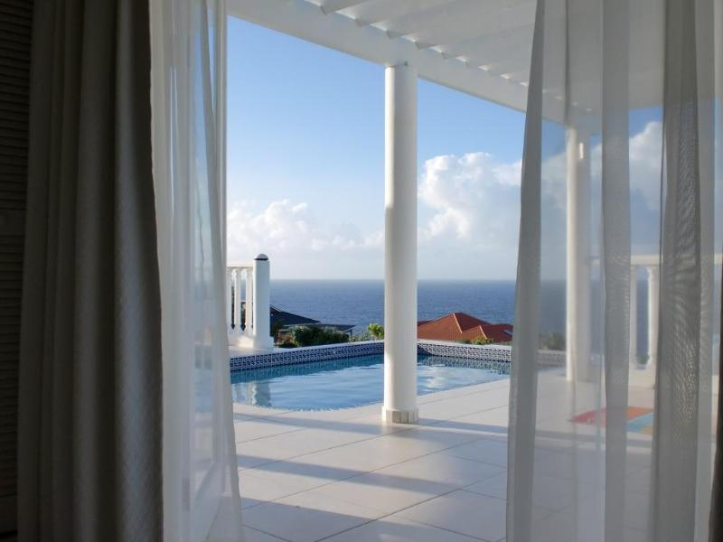 You are on holiday!  Wake up here!  View from the master bedroom French doors - Bonbini Villa -top reviews/views/service! - Curacao - rentals